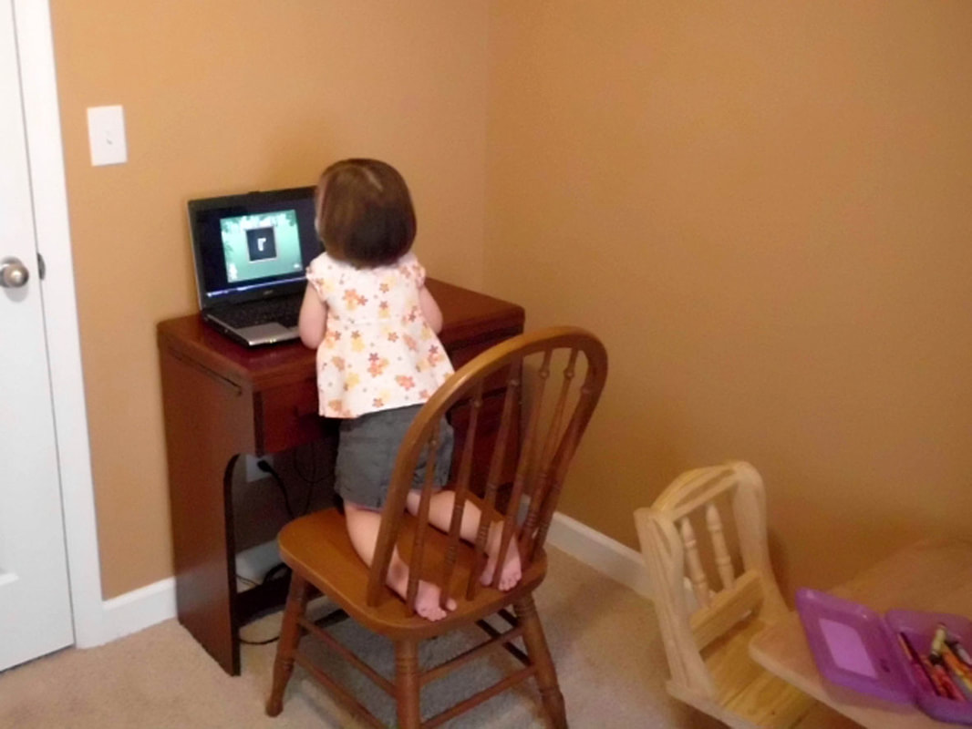child learning letters via computer